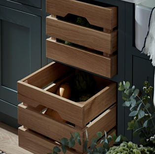 Solid oak vegetable drawer-crates are a storage piece of beauty – exactly what you'd expect from a Kitchen Makers kitchen.