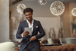 Canva - Cheerful businessman with tablet