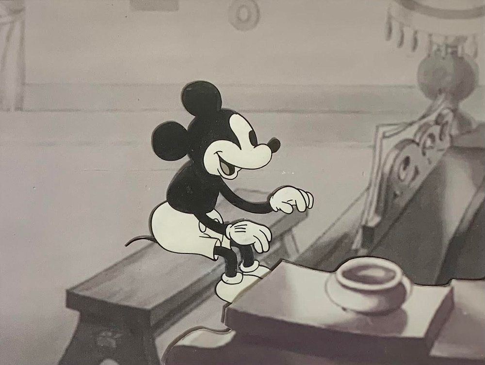 """Original Production Animation Cel of Mickey Mouse and Pluto from """"Puppy Love,"""" 1933"""