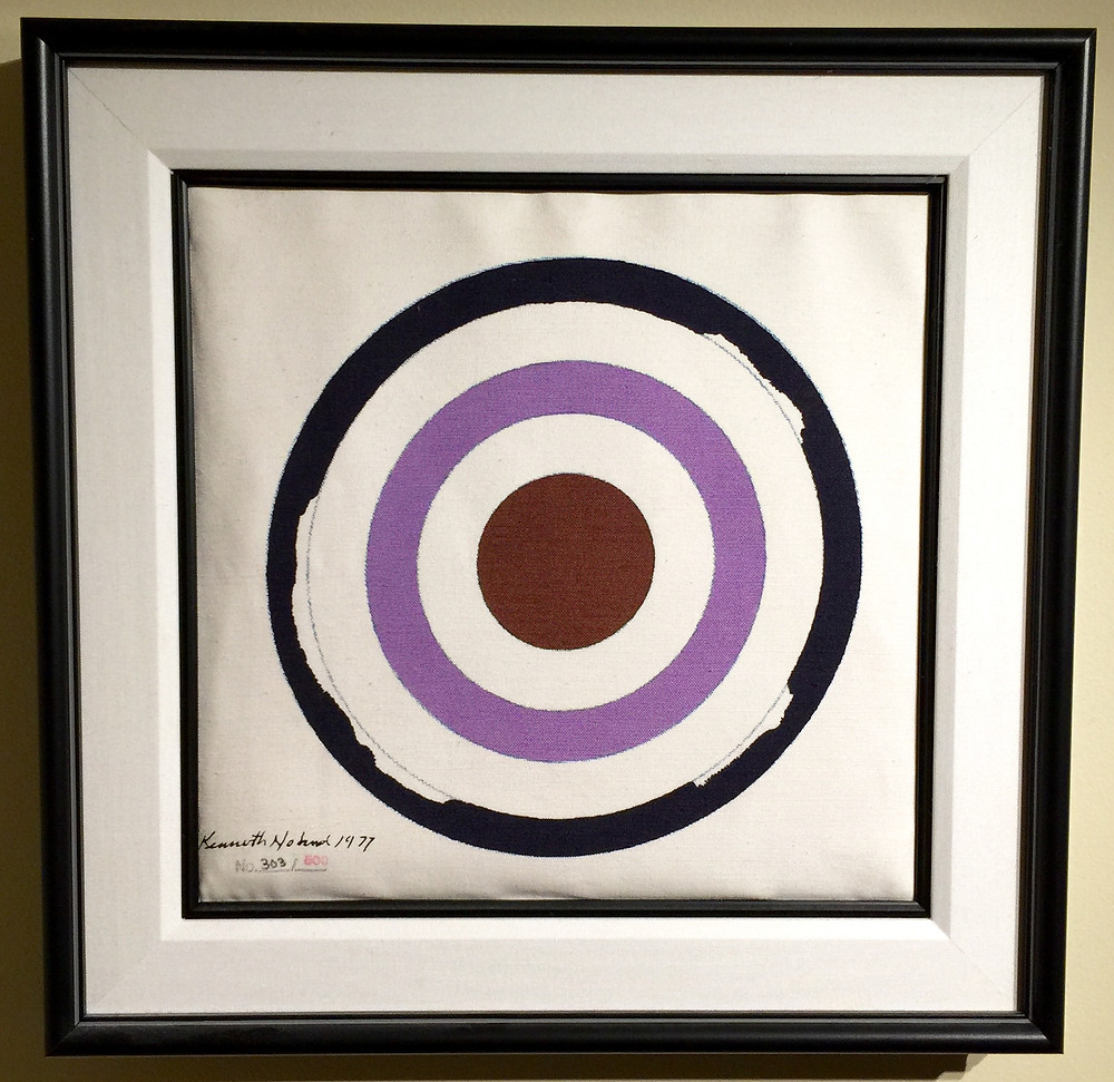 "Coach Tote Bag With Circle Painting 1977, 2002; Serigraph on canvas Coach bag; Stamp signed, dated, and numbered Kenneth Noland 1977, No. 303/500 lower left; Published by Coach Inc.; Framed using an acid-free linen liner, a black wood fillet, and a black wood frame; Size: Image 11 1/2"" x 11 1/2""; Bag 15"" x 15"" x 1""; Frame 20 1/4"" x 20 1/4"""