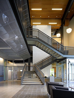 Three flight staircase in modern building.
