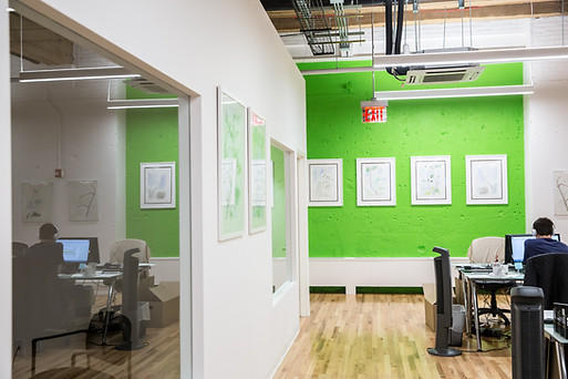Commercial office space with white and green wall.