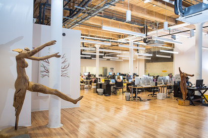 Human sculpture piece in an office space.