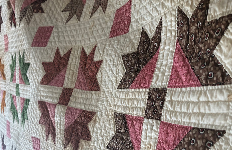 heirloom quilt circa 1860 multi-colored star pattern on white