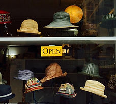The shop window of Mad as a Hatter, a hand made artisinal hattery in Provincetown MA