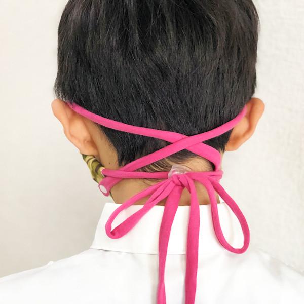 余った紐はカットするか、結んでまとめてください。