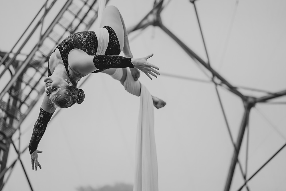 Performing aerial silks at a wedding at The Eden Project, Cornwall