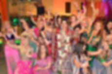 A bride and her hens at her wedding, performing the dance they learnt at their hen party