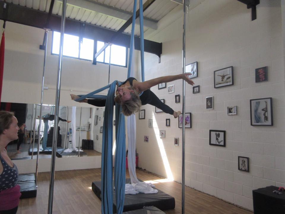 Gaynor excelling at learning a new move at Pole Dance Plymouth