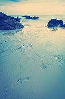 Footsteps in sand on a beach