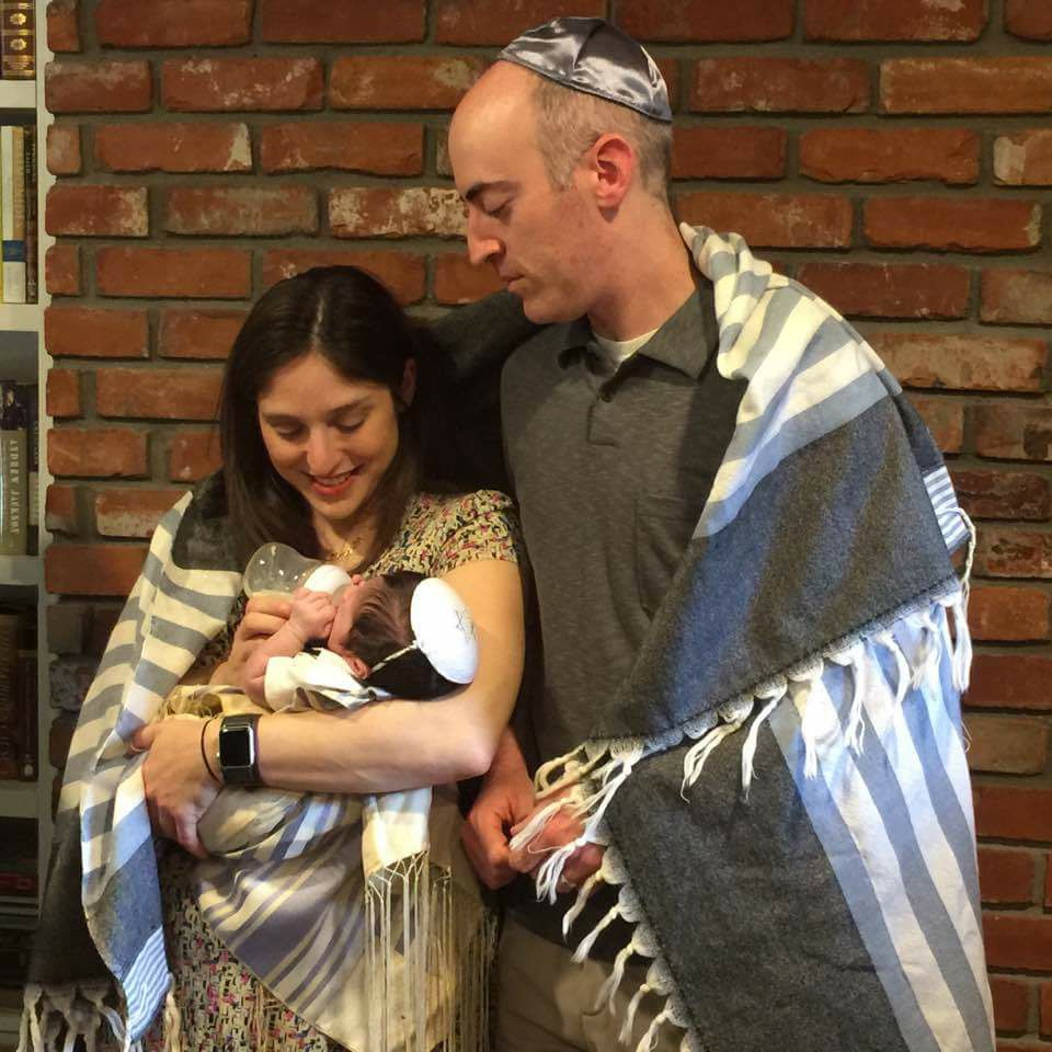 wrapped a couple in a tallit to welcome their new baby