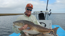 Captain Kenny and Clients in January 2014  issue of Angler Report