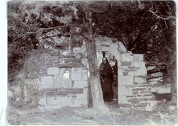 Dressed as a nun by the ruins