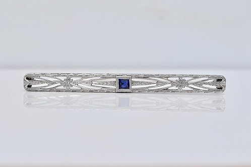 ART DECO PIN WITH CREATED SAPPHIRE AND FLORAL DETAILS