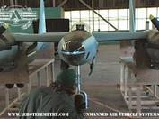 Joe Bok checks XF-11 nose wheel compartment prior to flight