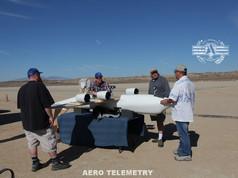 Aero Telemetry Flight Crew preparing for first flight test. Edwards Air Force Base, California. L-R: Justin Hall, Red Jensen - Pilot, Joe Bok, and Derek Abramson.