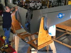 Preparing the lightweight one-piece wing for cross country shipping.