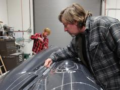 Joe Bok inspects rivet detail on finish coat of Aviator XF-11 pattern