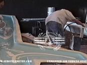Aero Telemetry personnel applying gel coat for the Aero Telemetry XF-11 fuselage section