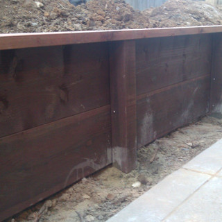 Pressure Treated Retainer Wall Installation