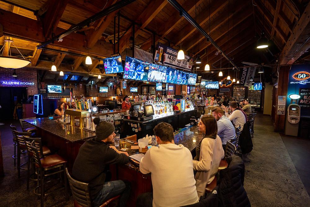 Fun Restaurants in Denver - Blake Street Tavern has plenty of TVs to watch Sports