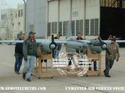 Joe Bok and flight crew pushing XF-11 out of hanger.