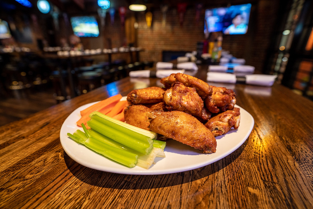 Free Downtown Denver Food & Alcohol Delivery - Try our popular chicken wings from Blake Street Tavern!