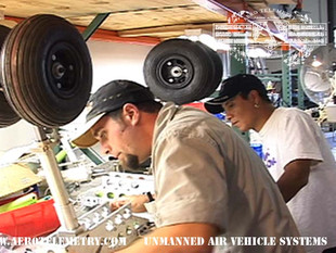 Butch and Cesar check XF-11 main gear fit and finish