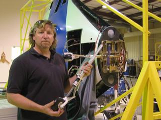 Joe Bok installing the nose wheel landing gear of the Boeing X-48