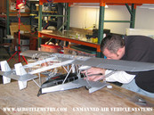 Darrel puts the finishing touches on the Aero Telemetry scale model of the Sikorsky S-38. This model was used for all the green screen and CG shots of the airplane flying.