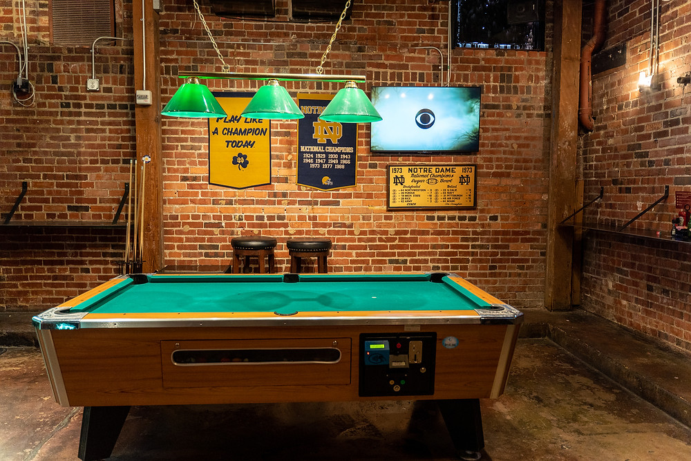 Underground Social Arcade Bar with Games and Bar Seating with plenty of TVs for hosting a Football Watch Party - with Pool Table