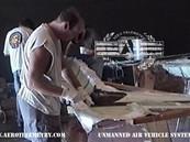 Ian applies carbon fiber reinforcement over fiberglass on the Aero Telemetry XF-11 fuselage