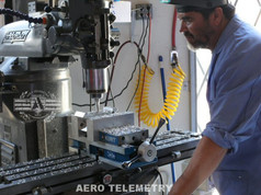 Aero Telemetry Master Machinist making landing gear parts for the Air Force One airplane.