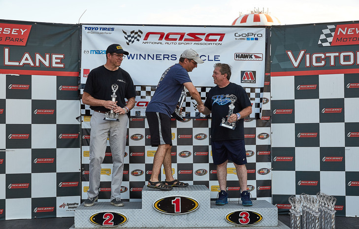 """Driver, Alan Cohen in the Winner's Circle taking 3rd Place at NJMP with NASA NE """"June Jam"""" (June 5-7, 2105)"""