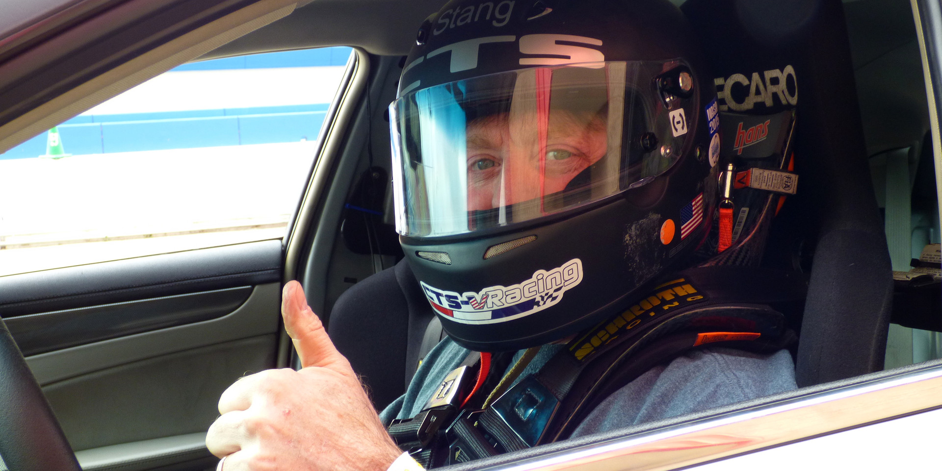 Driver, Alan Cohen giving a thumbs up at Cadillac Challenge: Round 1 at Autoclub Speedway (2-22-2015)