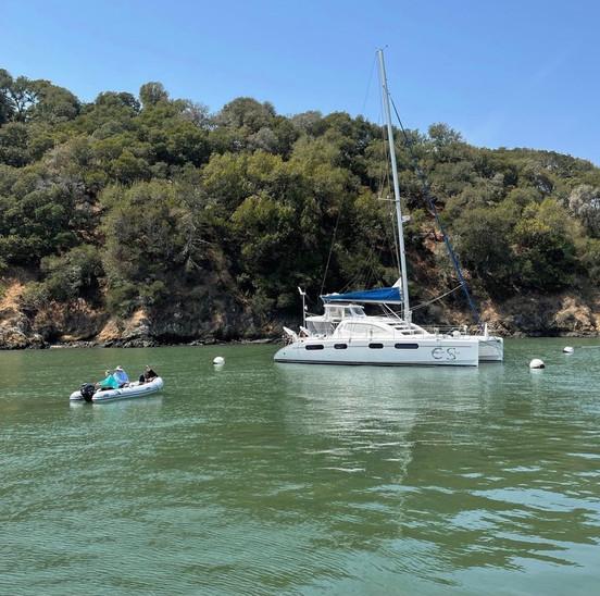 Deanna, James and Ethan dinghy their way back to Erin Skye.