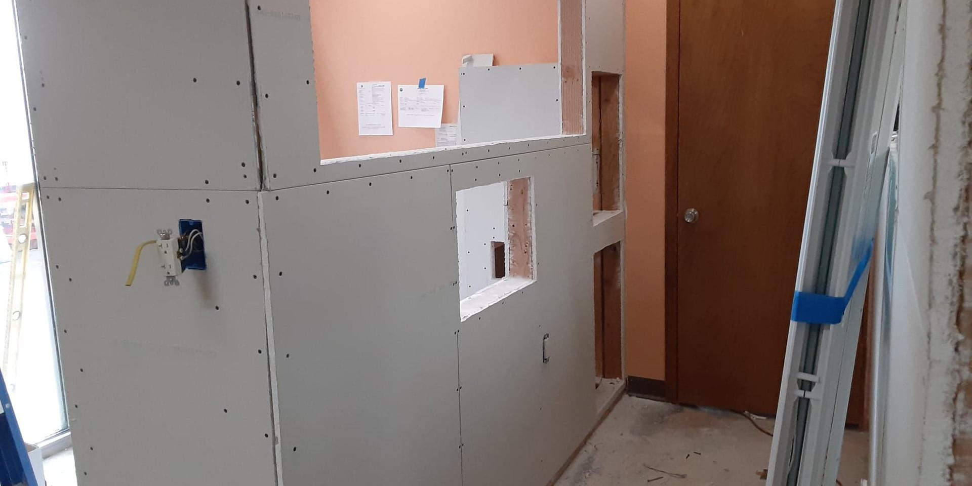 reception hallway sheetrock complete.jpg