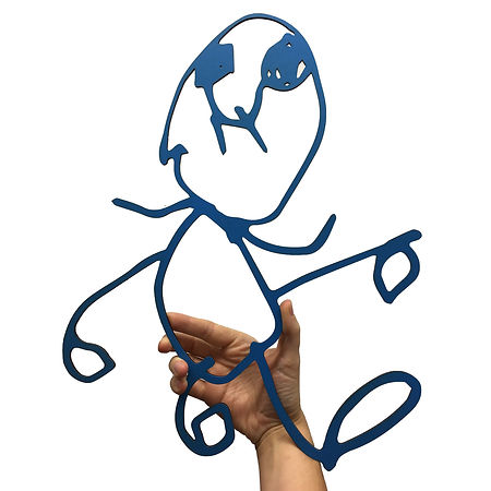 Photograph of a hnd holding a laser cut of a kids drawing. It a drawing of a man and it blue.