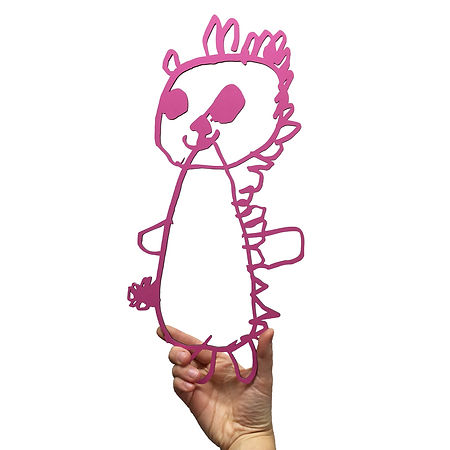 Photograph of a hand holding a laser cut kids drawing. The drawing is of a teddy and is pink.