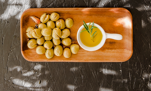 wooden-board-with-olives-oil_edited.png