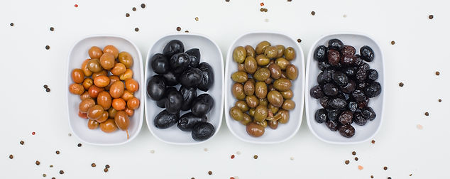 variety-olives-with-spices-white-plates-