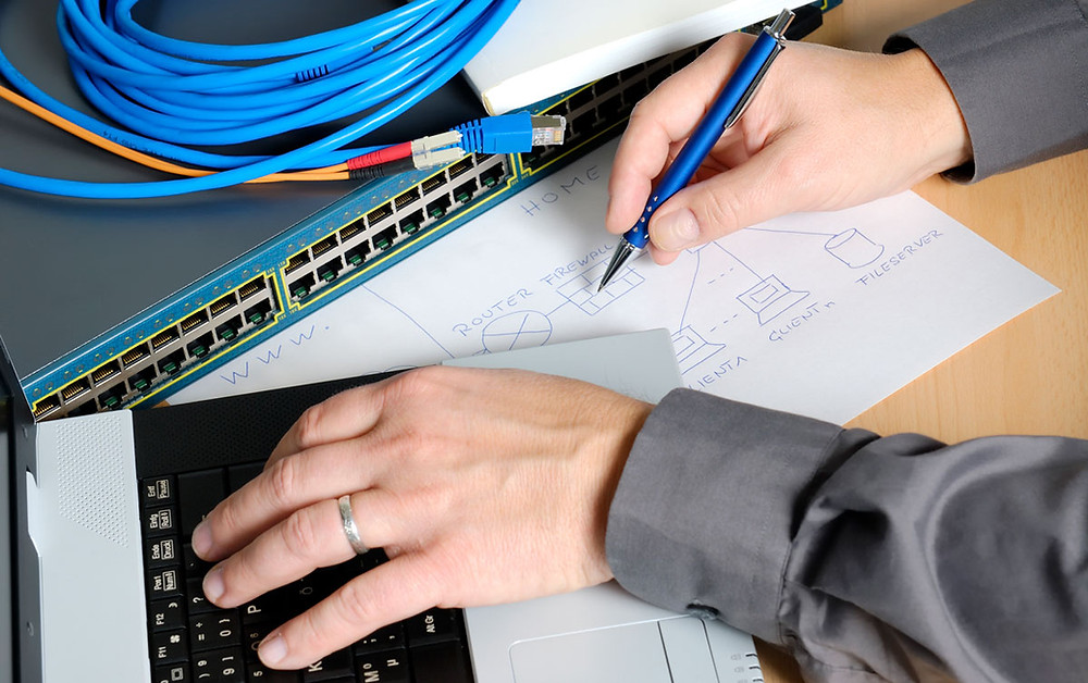 Man Drawing Home Network With Network Switch