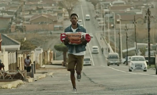 Kayli Vee Levitan, award-winning creative copywriter, worked on thi young man named sibusiso runs down a soweto street carrying dog food, because his parents don't do online shopping at takealot.com campaign where a young man named sibusiso, in running down a Soweto Street carrying do food because his parents don't shop online.