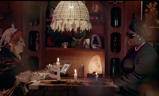 Kayli Vee Levitan, award-winning creative copywriter, worked on this campaign where mystic and widow sit in a purple caravan in front of an orb, and she shouts at dead husband Vusi because he should have got life insurance from Hollard.
