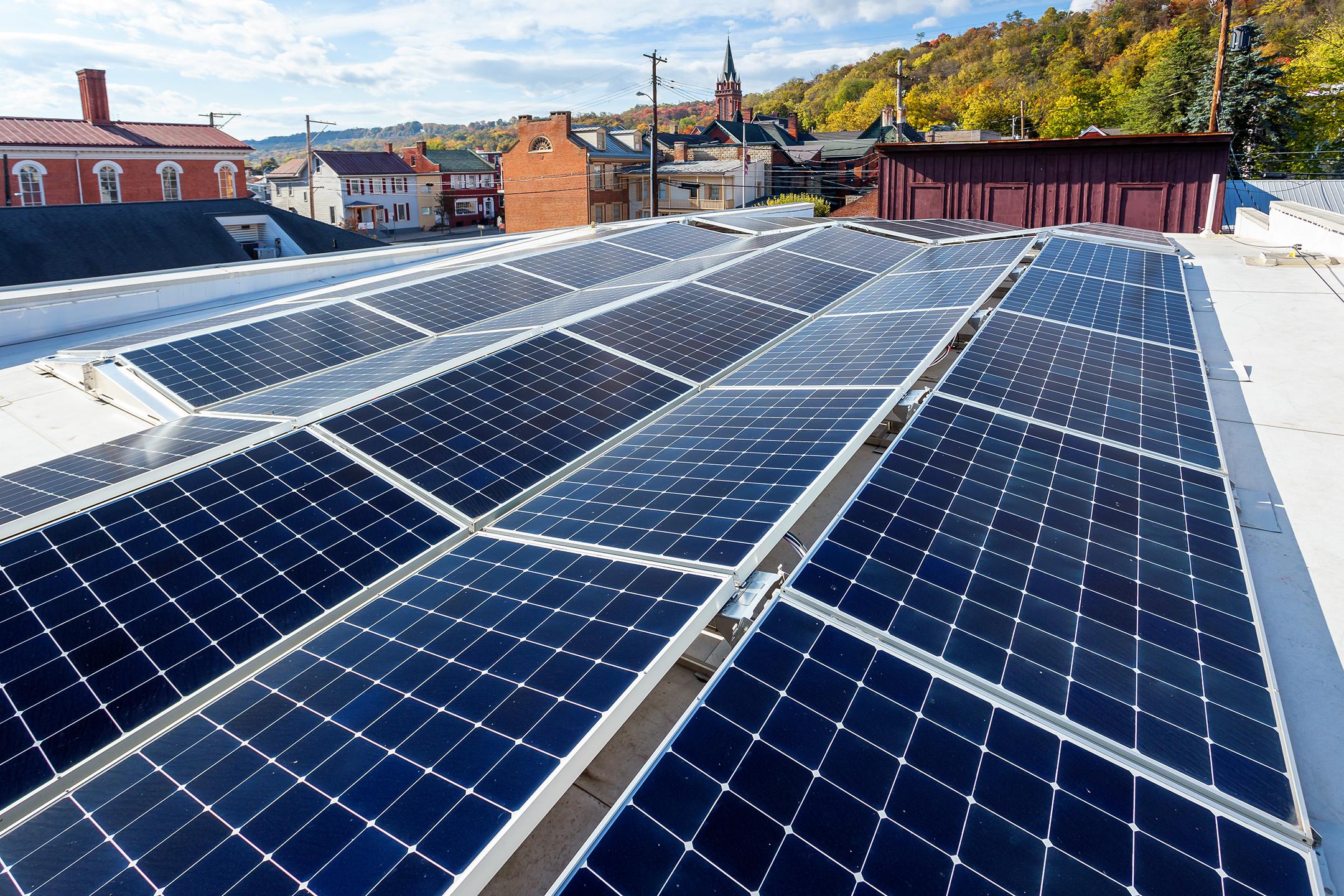 Dual tilt flat roof solar energy system