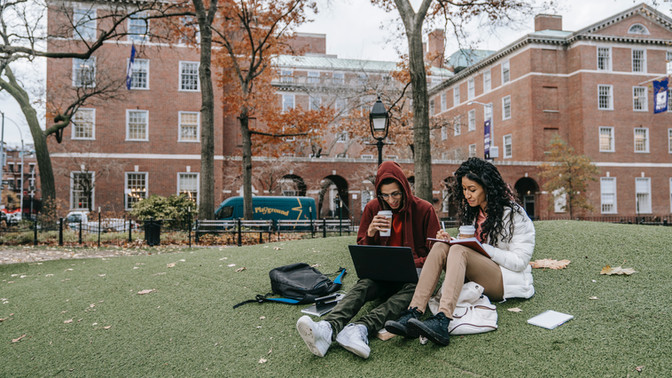 College students on grass reading