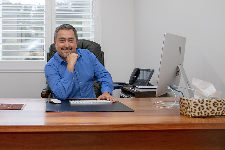 Dr Mark Romero at his desk