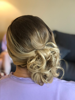 Textured bridal updo on the side