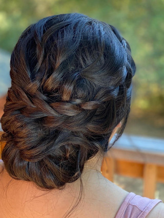 Textured bridal updo with braid.