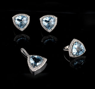Blue topaz and diamond earrings and pendant